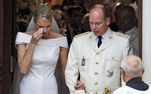 Charlene Princess of Monaco wipes tears as she leaves the Sainte Devote Church after her wedding to Prince Albert II of Monaco in Monaco